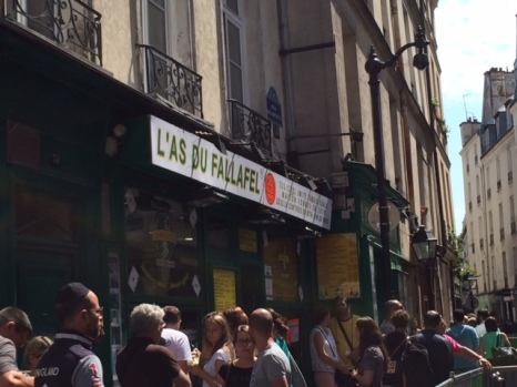 The crowd happily waits in line at L'As Du Falafel