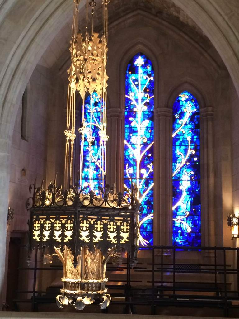 The Churchhill Porch window dedicated to Winston Churchill. The blue and yellow glass reflecting his favorite colors.